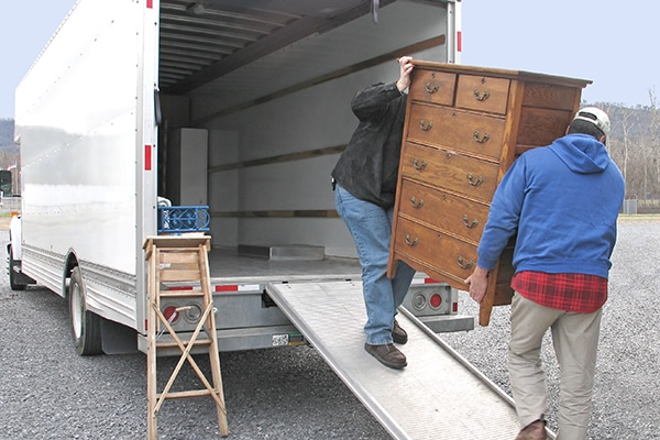 Eco Movers staff moving furniture